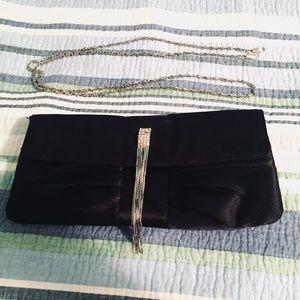Cache black bow clutch | attachable silver straps